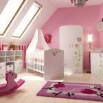 Розово-белая детская для девочки в мансарде