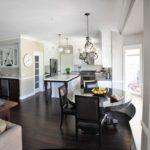 Серый цвет и чёрная мебель смотрятся лаконично в маленьких квартирах