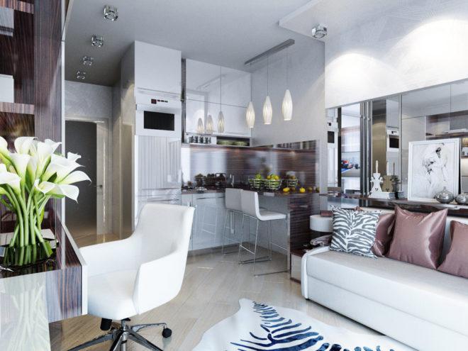 Квартира-студия с точечными светильниками и люстрой