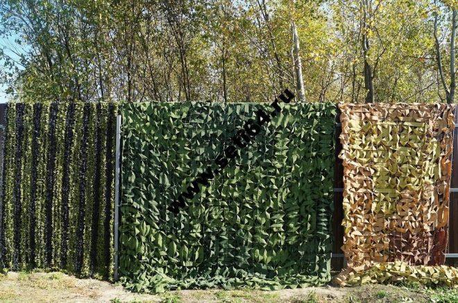 Забор, закрытый камуфляжной сеткой
