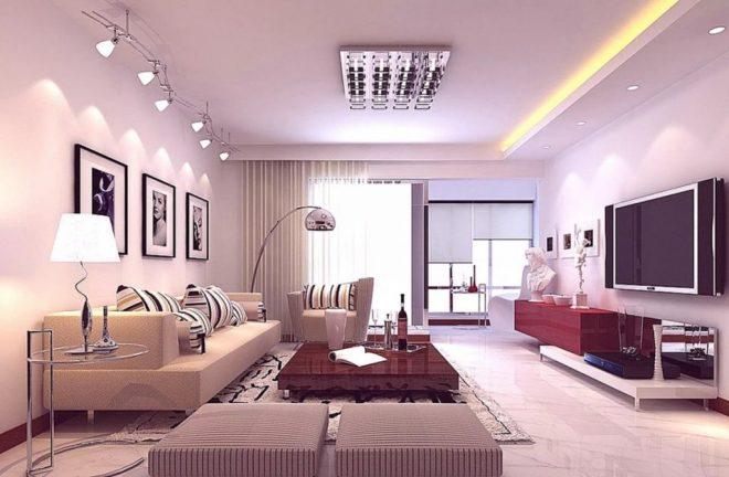 Множество элементов освещения в интерьере гостиной